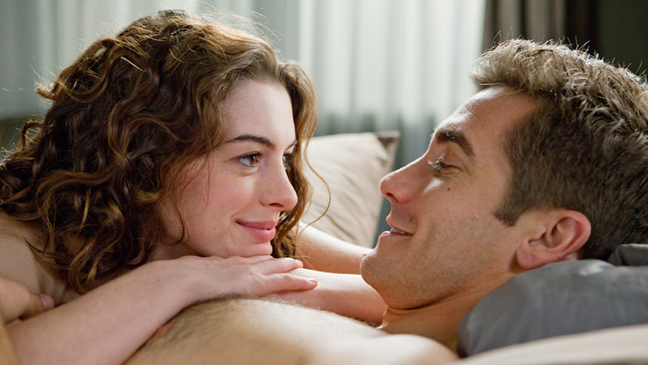 Love and Other Drugs - Movie Still Anne Hathaway and Jake Gyllenhaal close-up in bed - 2010