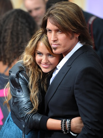 Miley Cyrus & Billy Ray Cyrus - At the world premiere of the 'Hannah Montana the Movie' - 2009