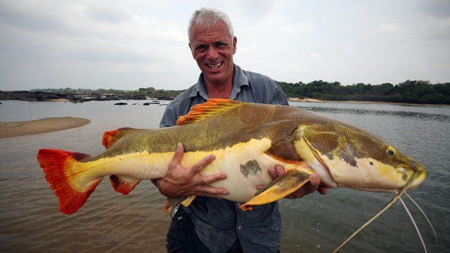 River Monsters - TV Still: Jeremy holding a Red-Tailed Catfish. Araguaia River - 2010