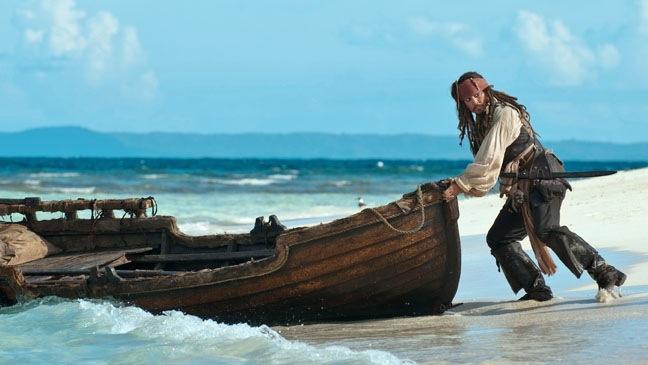 Pirates of the Caribbean: On Stranger Tides - Movie Still: Johnny Depp w boat - 2011