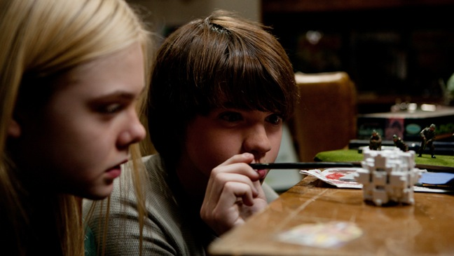 Super 8 - Movie Still: Elle Fanning plays Alice Dainard and Joel Courtney plays Joe Lamb  - 2011