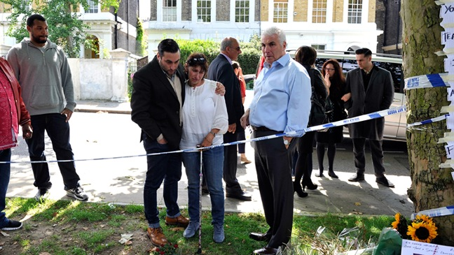 Mitch Winehouse, Janis Winehouse, Alex Winehouse - At floral tributes left at Amy's house by fans - H - 2011