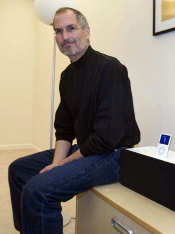 Steve Jobs Seated With iPod in Speaker