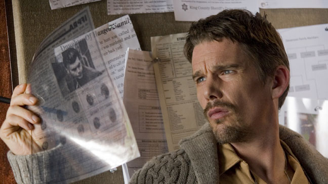Sinister Ethan Hawk Looking at Police Files - H 2012