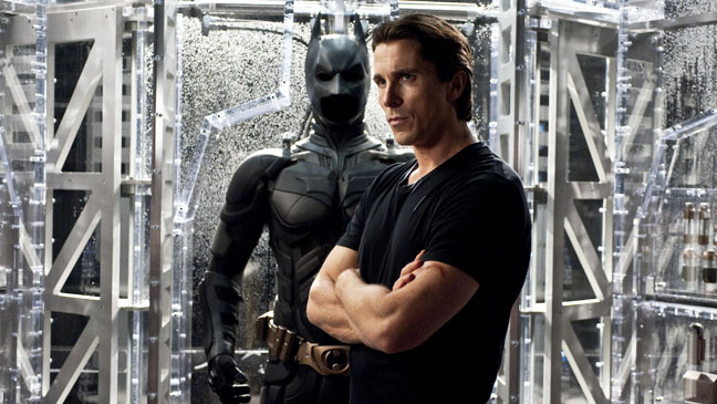 Dark Knight Rises Bale next to Batman Suit - H 2012