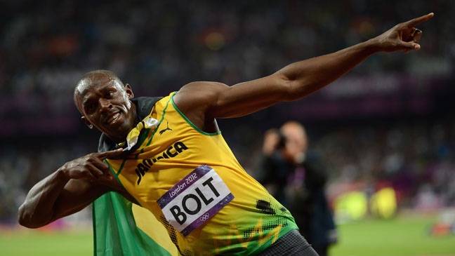 Usain Bolt Defends Olympic Title