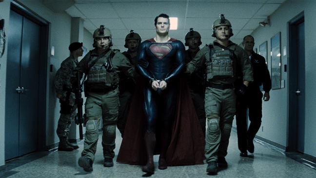 Man of Steel Cavill Escorted by Officers - H 2013