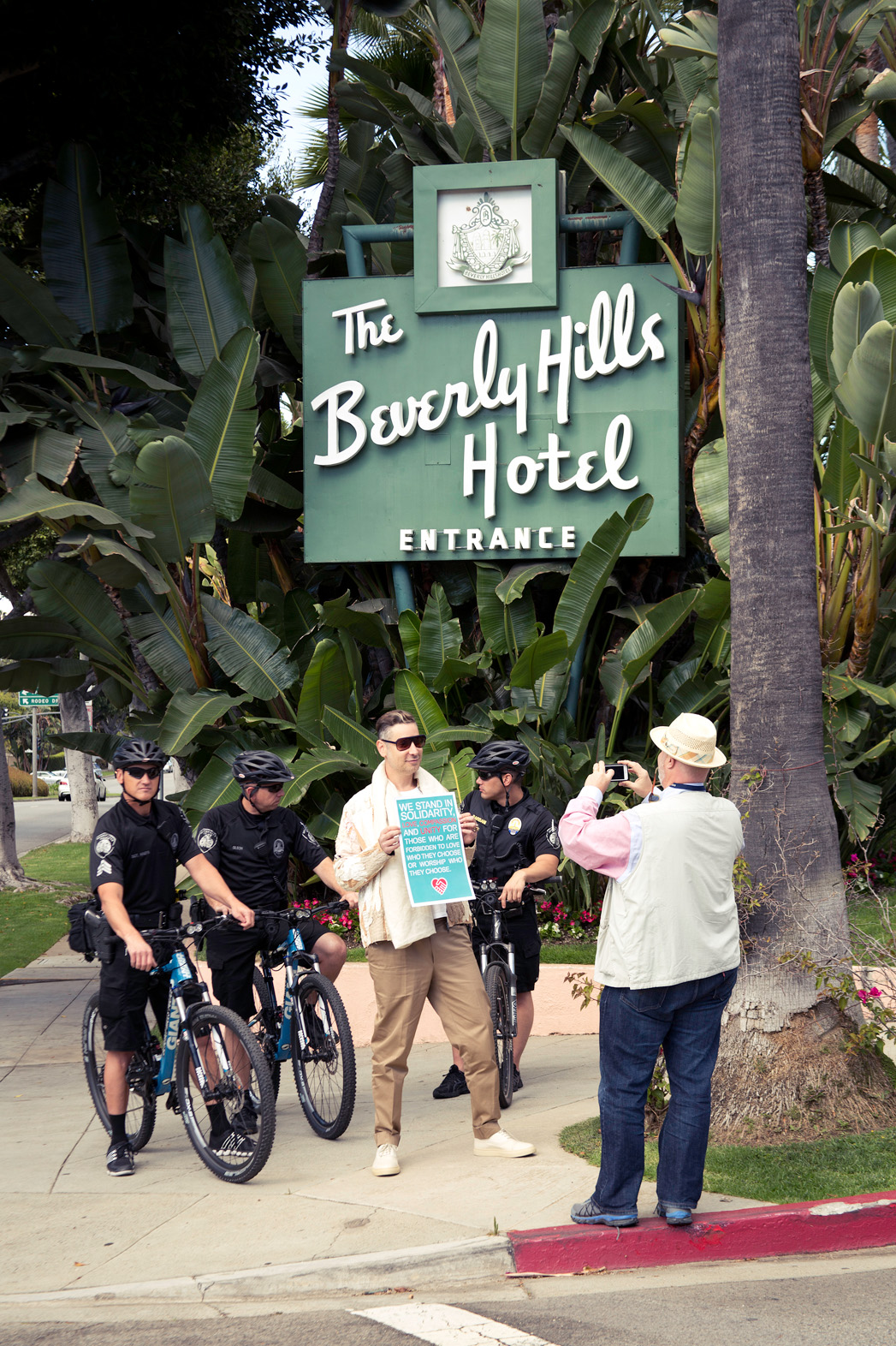 Beverly Hills Hotel Protest Protester Posing With Police - P 2014