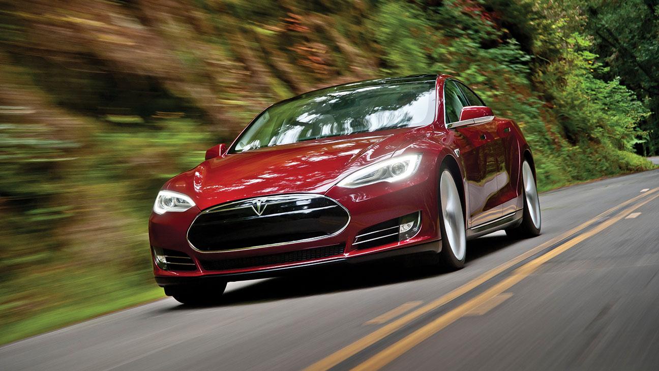 Red Tesla Model S on Road - H 2014