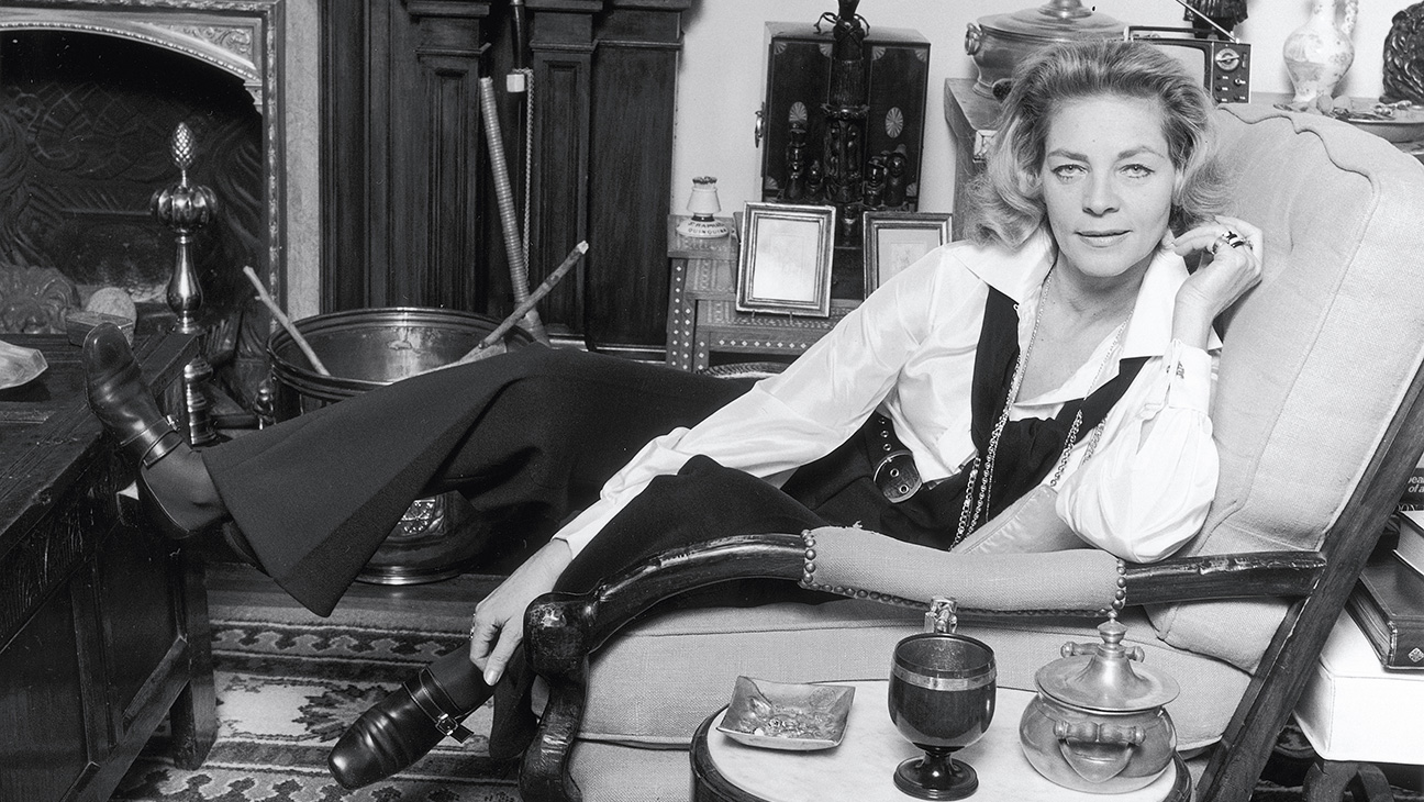 Bacall in Her Apartment Library
