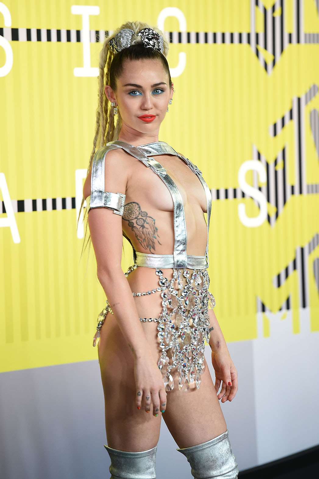 Mtv Vmas A Breakdown Of Miley Cyrus Outrageous Outfits Hollywood Reporter
