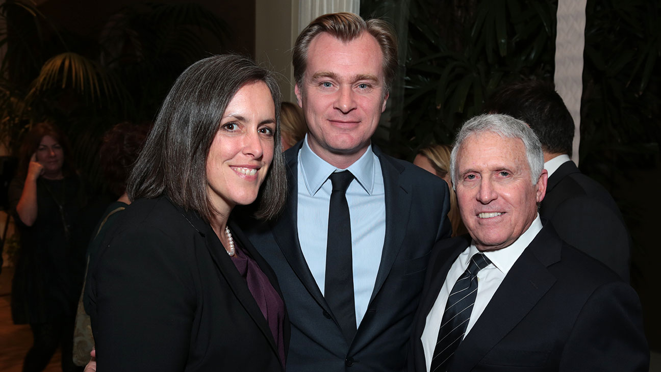 Emma Thomas and Christopher Nolan pose with Dan Fellman at his Retirement Party - H 2015