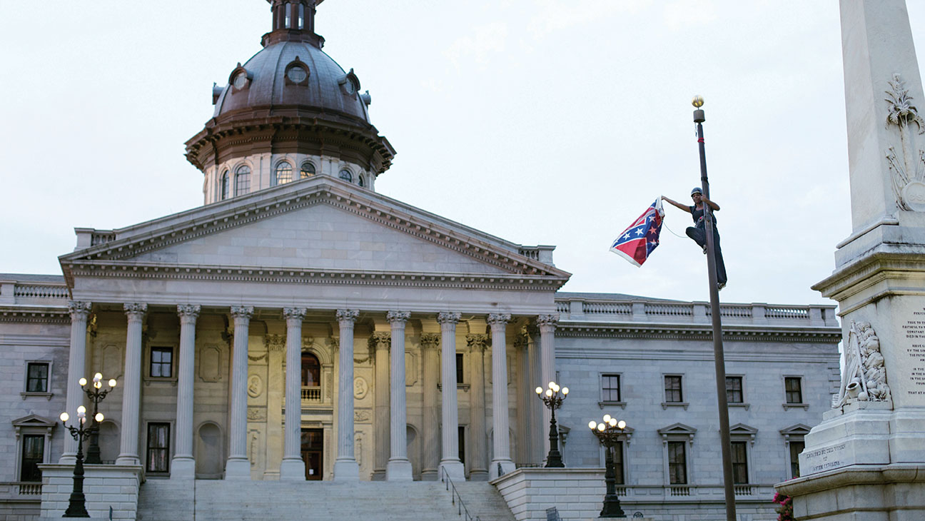 Bree Newsome removes Confederate flag from a pole at the Statehouse in Columbia SC - H 2016