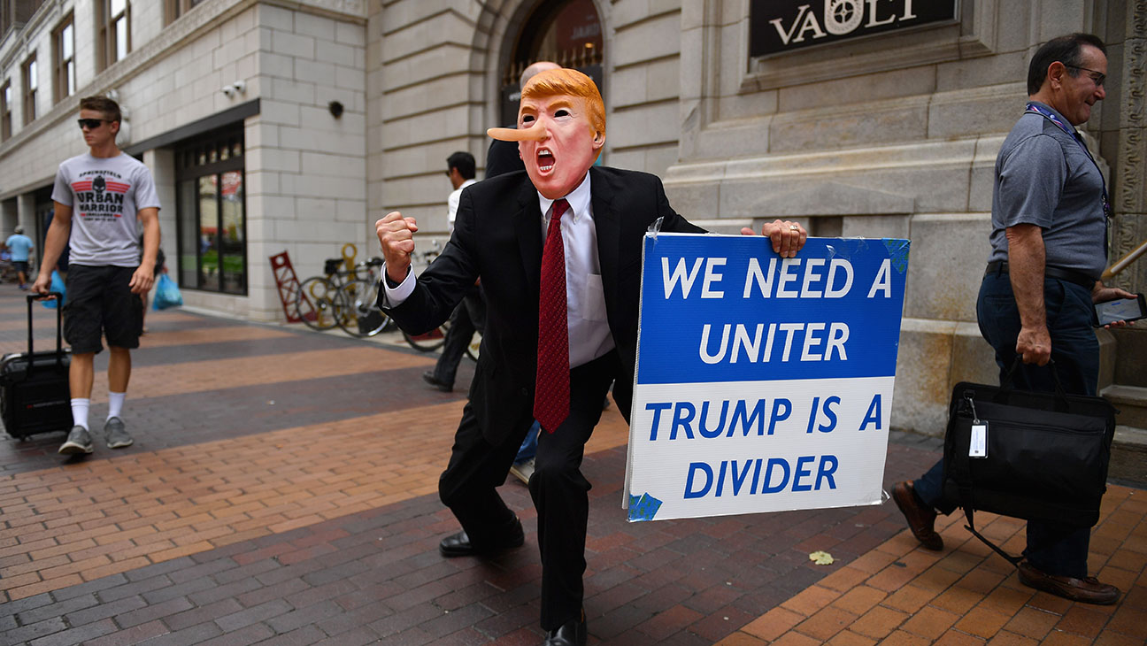 Trump Masked Protester - Getty - H 2016