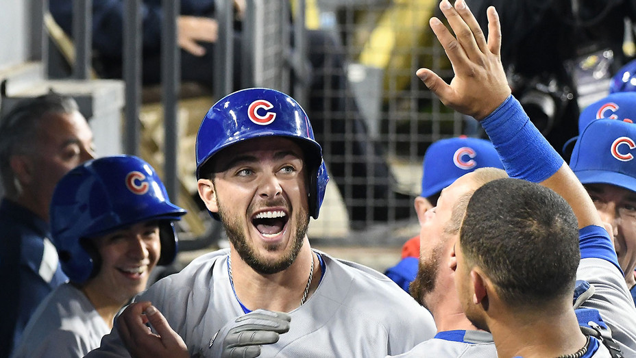 Kris Bryant 17 of the Chicago Cubs - celebrates in the dugout -2 run home runs-Getty-H 2016