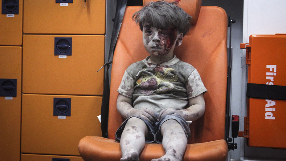 ALEPPO SYRIA -Syrian Omran Daqneesh sits alone in the back of the ambulance-Getty-ONE TIME USE-H 2016