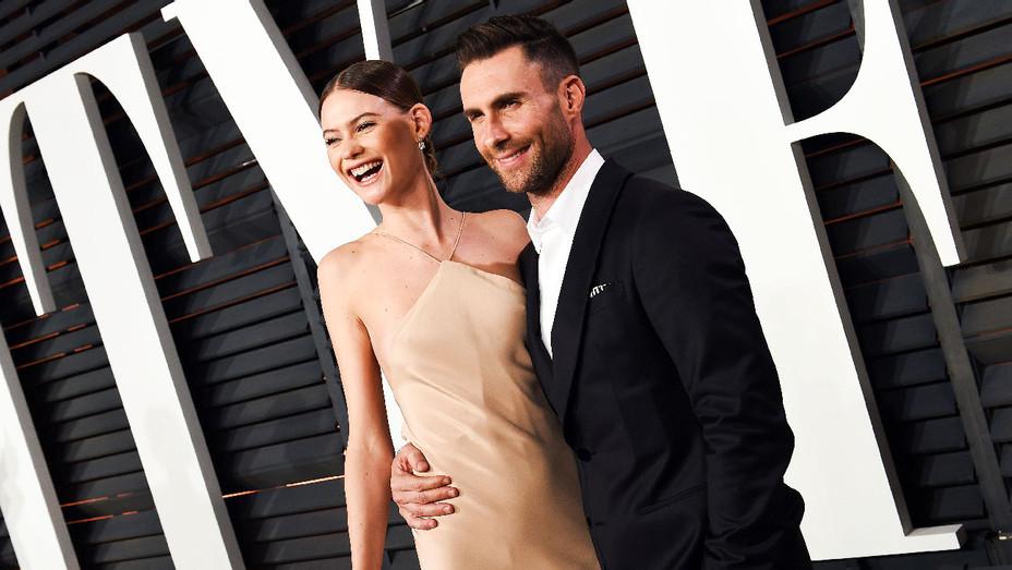 Behati Prinsloo and Adam Levine - 2015 Vanity Fair Oscar Party - Getty - H 2017