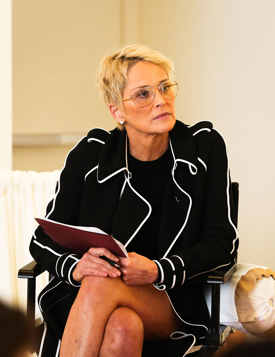 Moderator Sharon Stone, wearing a black trench coat with white piping from the Paule Ka Pre-Fall 2017 Collection, looks on at the panelists during a discussion for Women's Brain Health Initiative at Gagosian Gallery in Beverly Hills on Oct. 18, 2017. (Photo: John Salangsang/BFA.com)