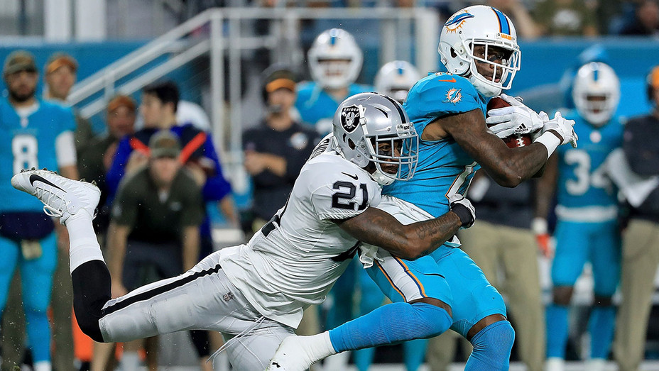 DeVante Parker  of Miami Dolphins is tackled by Sean Smith #21 of the Oakland Raiders - Getty-H 2017