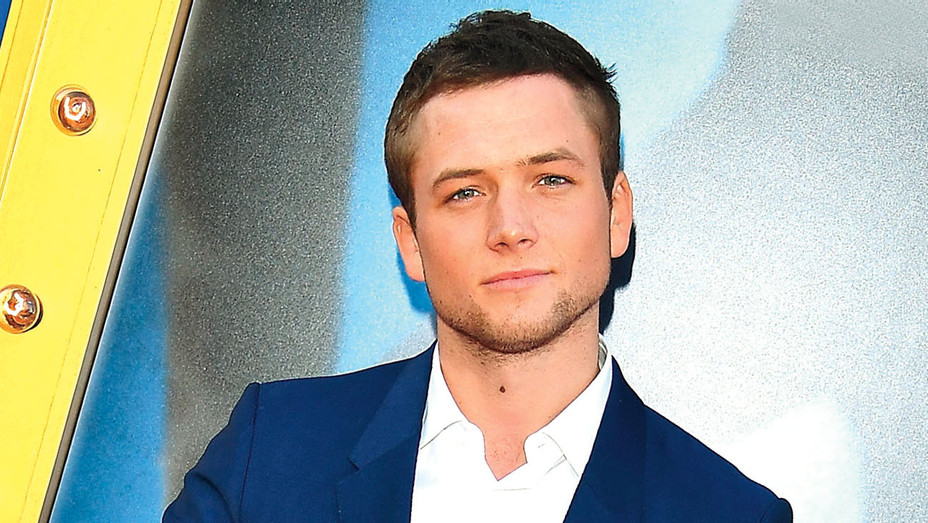 Taron Egerton arrives at the Premiere Of Universal Pictures - Getty -H 2018