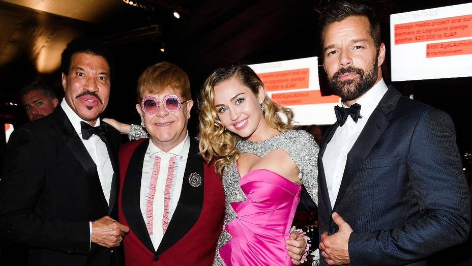 Lionel Richie, Sir Elton John, Miley Cyrus and Ricky Martin - AIDS Foundation Gala - Getty - H 2018