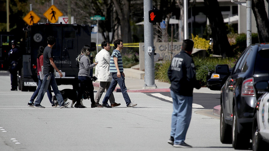 Police look on as employees walk across the street - YouTube headquarters on April 3, 2018 -Getty-H 2018