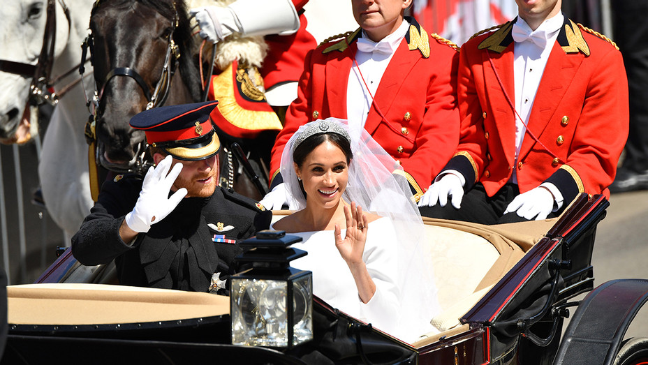 Prince Harry Meghan Markle Carriage Wave Leaving St Georges Chapel - Getty - H 2018