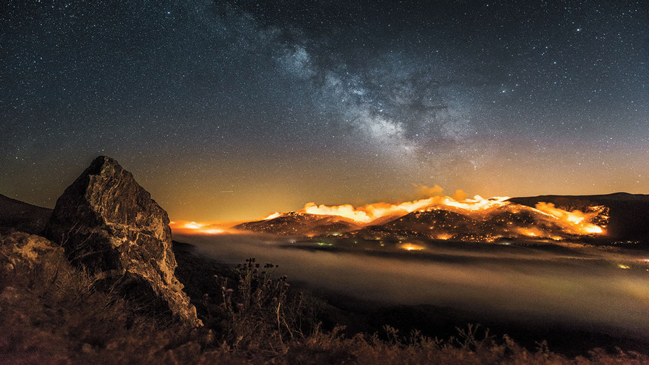 National Geographic - Time-lapse burning hillside with Milky way above-Publicity-H 2018