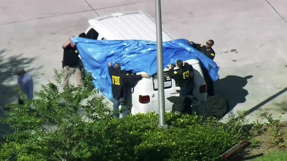 ONE TIME USE ONLY-WPLG-TV, FBI agents cover a van parked in Plantation, Fla., on Friday, Oct. 26, 2018 - AP Photo-H 2018