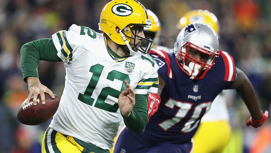 Green Bay Packers scrambles with the ball during the first half against the New England Patriots - Getty-H 2018