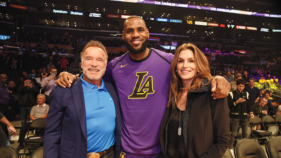 ONE TIME USE ONLY-Lakers games-Cindy Crawford and Arnold Schwarzenegger and LeBron James-Getty-H 2018