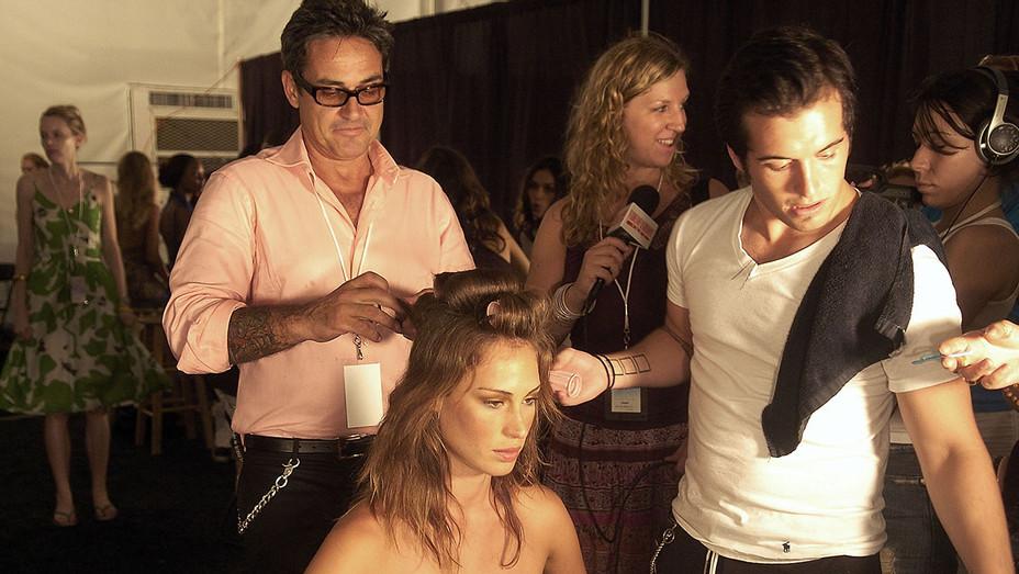 Oribe- prepares backstage at the Cosabella Mare 2006 fashion presentation-Getty-H 2018