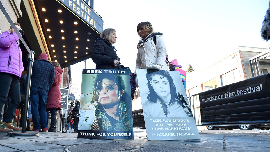 Brenda Jenkyns and Catherine Van Tigem protest the film 'Leaving Neverland' -Getty-H 2019