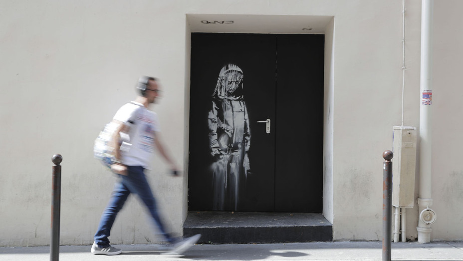 ONE TIME USE ONLY- Artwork by street artist Banksy Paris 2015- Bataclan concert hall - Getty-H 2019