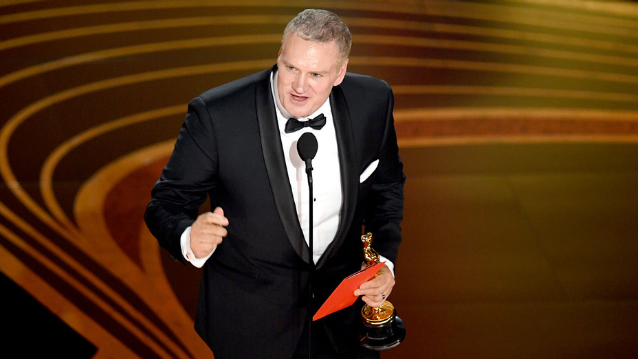 John Ottman accepts the Film Editing award for 'Bohemian Rhapsody' onstage during the 91st Annual Academy Awards-Oscars 2019-Getty-H 2019