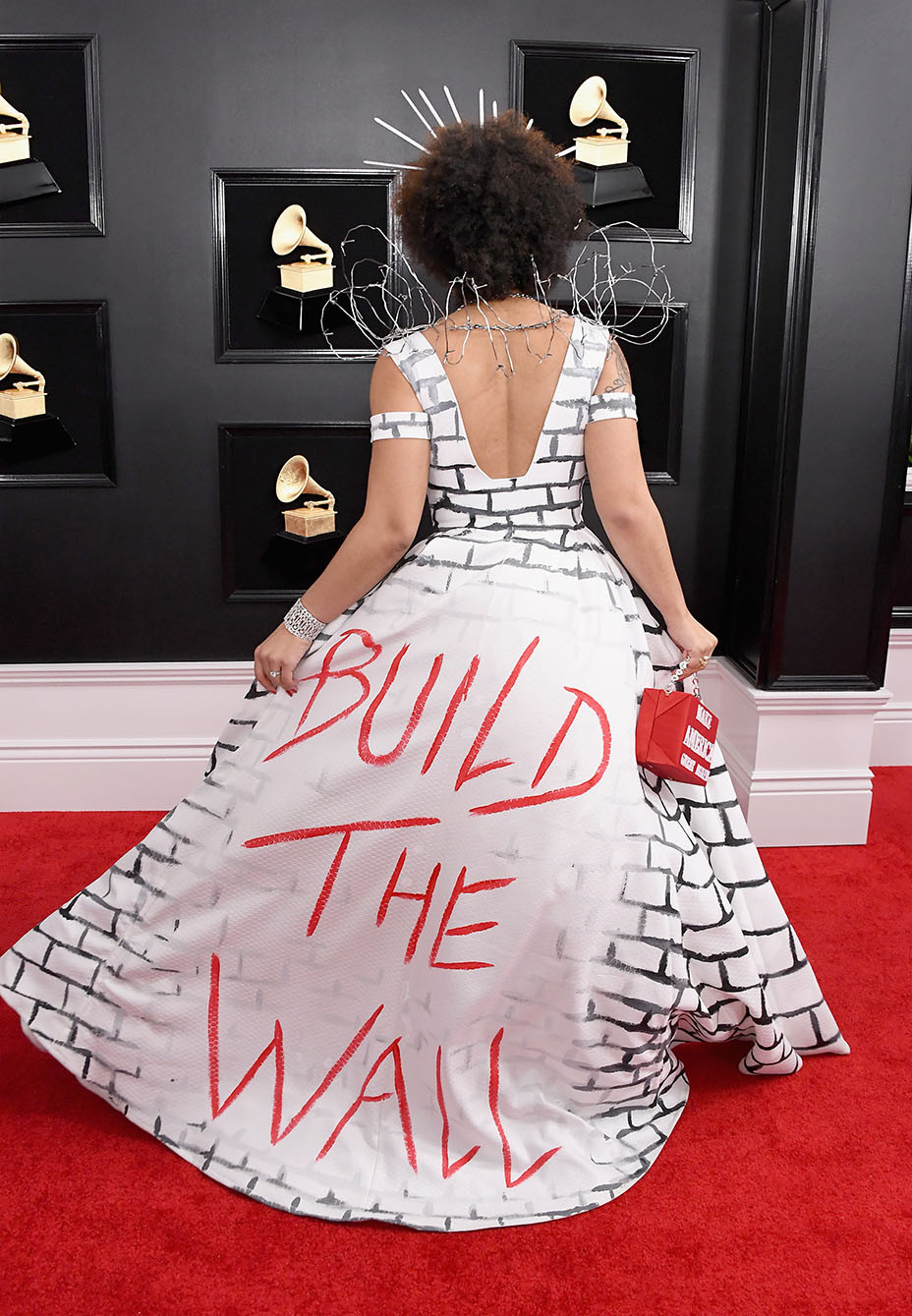 singer shocks in barbed wire build the wall gown on grammys red carpet hollywood reporter barbed wire build the wall gown