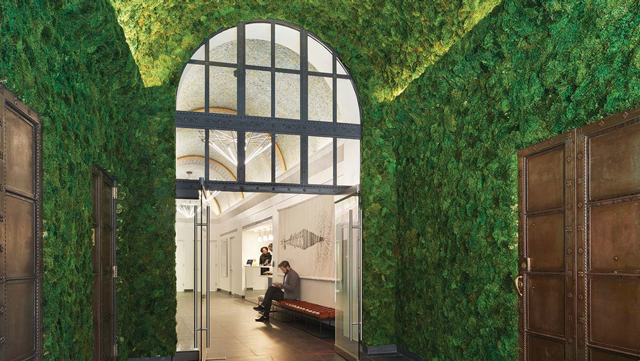 The arched - moss-covered entry at Assemblage Hotel - H 2019