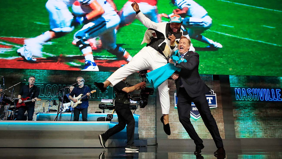 Christian Wilkins of Clemson celebrates with NFL Commissioner Roger Goodell 0 Getty-H 2019
