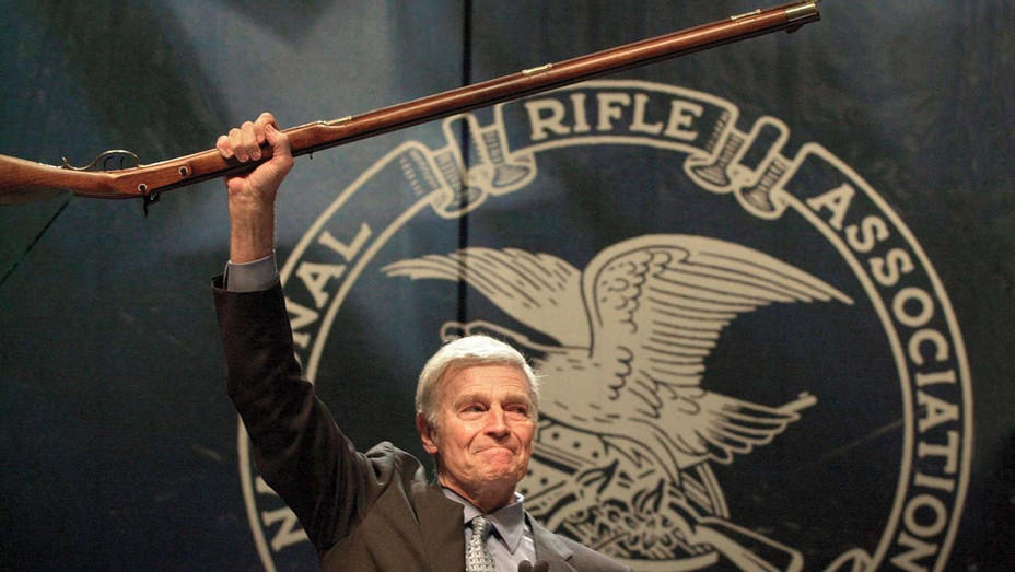 ONE TIME USE ONLY-Charlton Heston holds up a musket -May 20, 2000- AP photo-H 2019