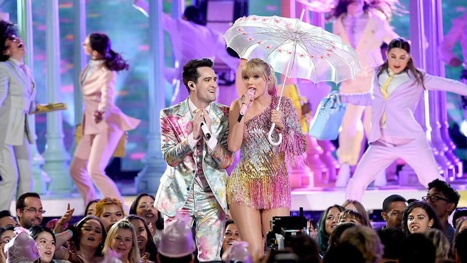 Brendon Urie of Panic! at the Disco and Taylor Swift perform onstage during the 2019 Billboard Music Awards -Getty-H 2019