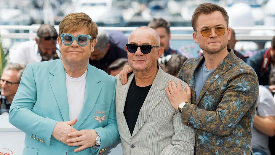 "Elton John, Bernie Taupin and Taron Egerton attend the photocall for ""Rocketman"" - Getty-H 2019"