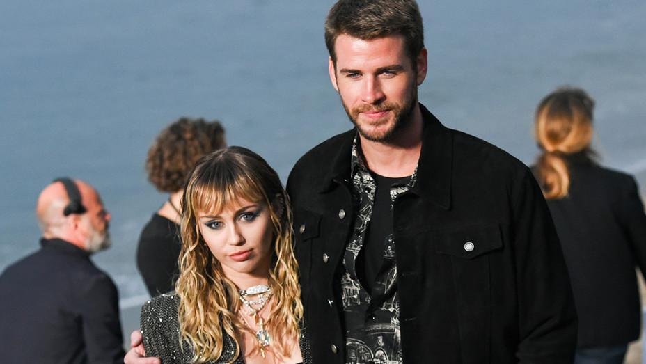 Miley Cyrus Liam Hemsworth Saint Laurent Malibu - Getty - H 2019