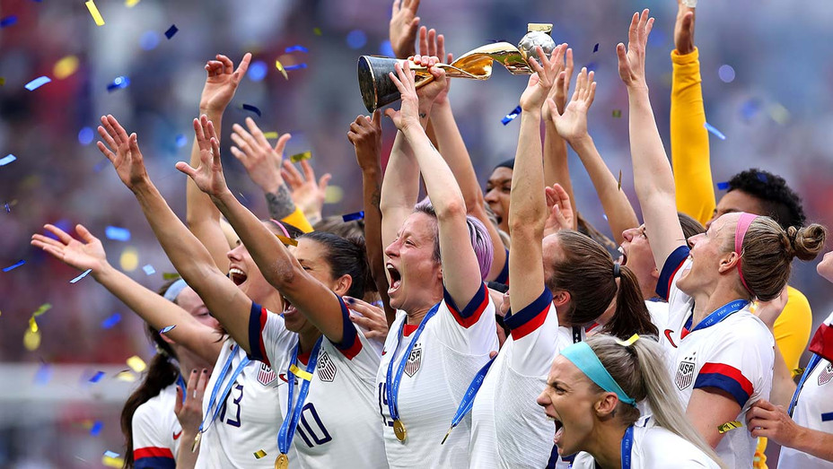 Megan Rapinoe of the USA lifts the FIFA Women's World Cup Trophy following her team's victory in the 2019 - Getty-H 2019