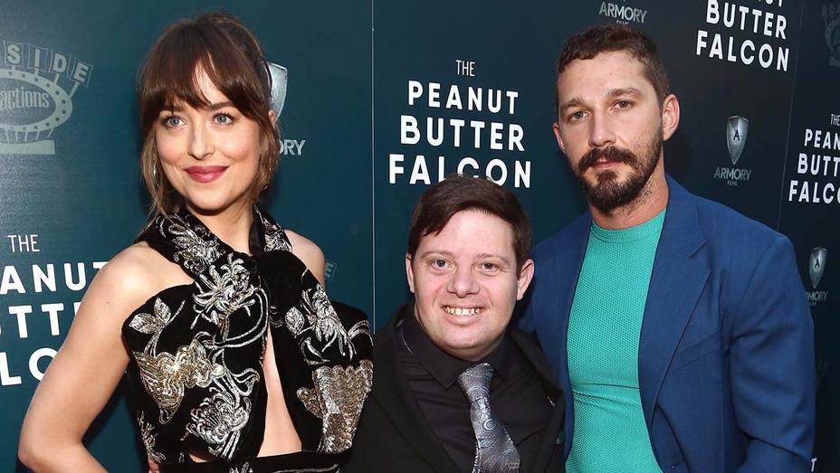 Dakota Johnson, Zack Gottsagen and Shia LaBeou-Getty-H 2019