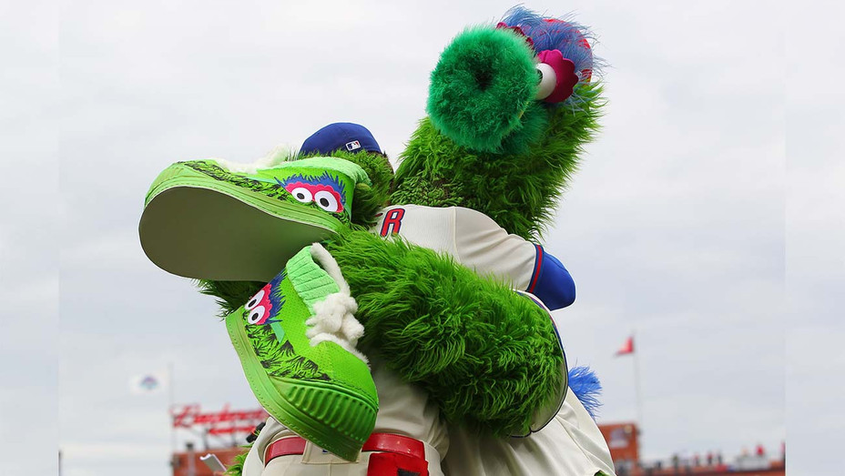 The Phillie Phanatic is hugged by Bryce Harper #3 of the Philadelphia Phillies-Getty-H 2019