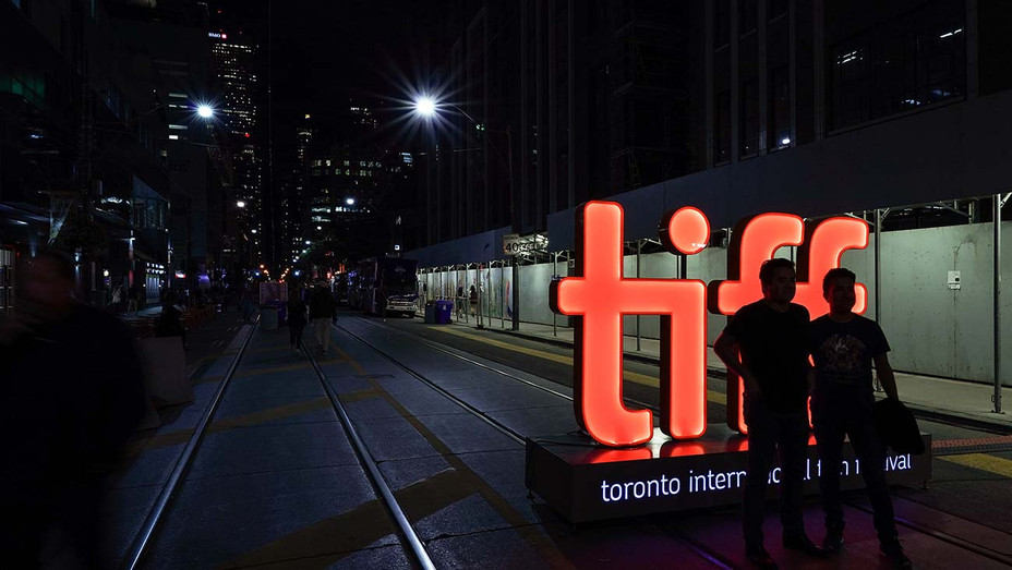 TIFF- Members of the public pose for photos in front of the TIFF sign on King Street - Getty-H 2019