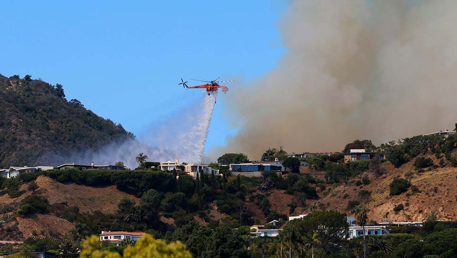 ONE TIME USE ONLY -Pacific Palisades Fire - A helicopter makes a water drop as flames threaten homes - Shutterstock-H 2019