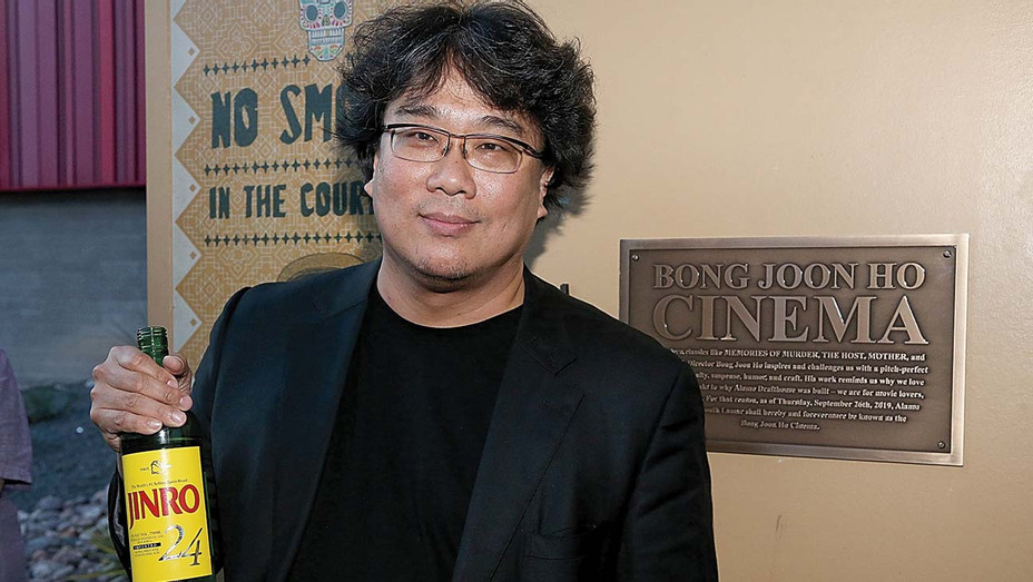 Bong Joon Ho stands next to a plaque renaming the South Lamar location the Bong Joon Ho Cinema -September 26, 2019 - Getty-H 2019