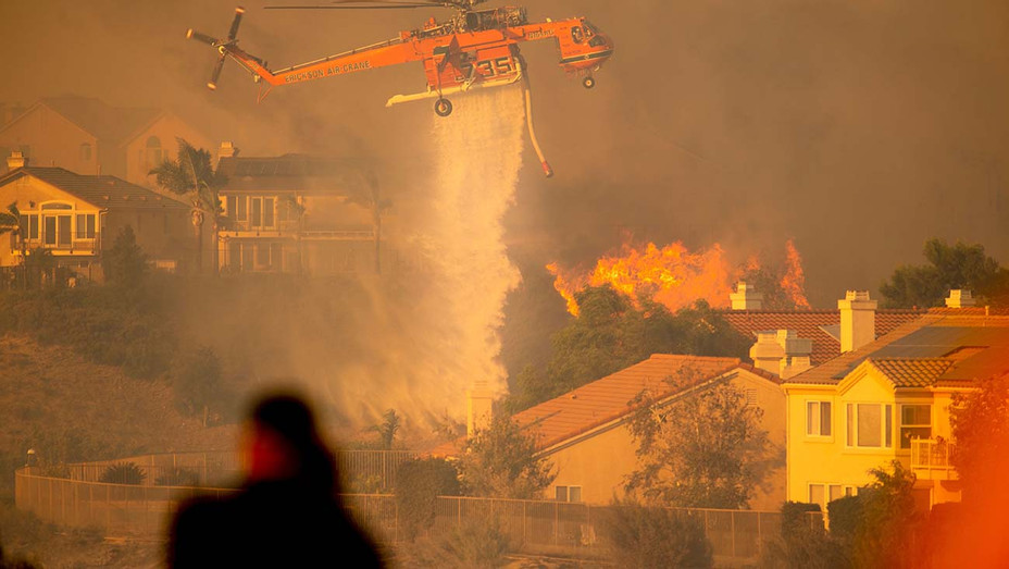 A helicopter drops water - Saddleridge Fire in the Porter Ranch section of Los Angeles, California on October 11, 2019 - Getty -H 2019