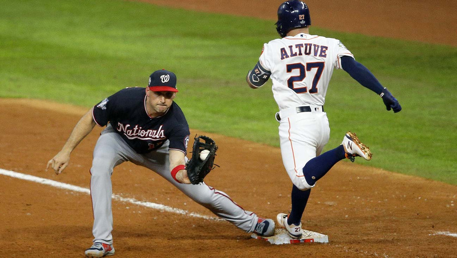 Game Six of the 2019 World Series -Jose Altuve #27 of the Houston Astros is out at first base on a putout by Ryan Zimmerman #11 of the Washington Nationals - Getty-H 2019